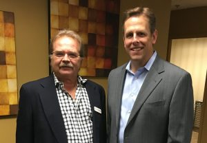 Jeffrey Barnhart, CEO and president of CMA and Robert Hogg, executive director of Ancero at the wine tasting to benefit Trenton Digital Initiative at the IT consulting company's office in Mount Laurel.