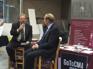 Creative Marketing Alliance (CMA) CEO Jeffrey Barnhart talks with Sen. Raymond Lesniak (D-20) about business growth and social media at the MIDJersey Chamber of Commerce Spring Showcase at Mercer County Park last week.