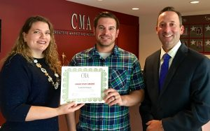 Victoria Hurley-Schubert, public relations and social media specialist and first quarter Crew Star (left) and Christian Amato, COO (right) present Todd DeFilippis, senior accountant (center) the Crew Star award for the second quarter.