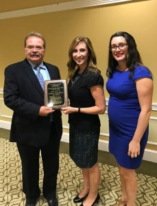 Jeffrey Barnhart, president and CEO of Creative Marketing Alliance, Tana Smith, principal, Hopewell Valley Central High School, and Erin Klebaur, director of marketing services at Creative Marketing Alliance, after he was introduced as a Distinguished Graduate on October 20.