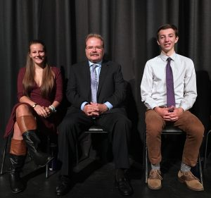 Jeffrey Barnhart, president and CEO of Creative Marketing Alliance, is pictured with two seniors from Hopewell Valley Central High School moments before he was introduced to the student body as a Distinguished Graduate on October 20.